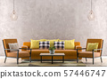 Orange sofa with yellow pillows. Empty wall in 57446747