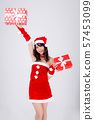 Beautiful portrait young asian woman happy holding red gift box with excited in xmas holiday 57453099