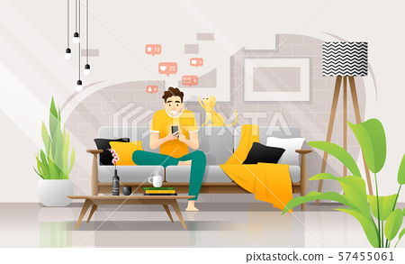 Happy young man using smartphone while sitting on sofa in living room, relaxing at home with his cat 57455061