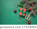 Christmas tree branches, red glass balls and gift 57458064