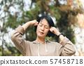 mature Asian woman have headache 57458718