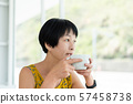 Asian woman hold a cup of coffee 57458738