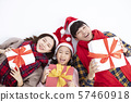 happy family lying on floor and showing christmas 57460918