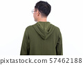 Rear view of Japanese man with eyeglasses looking over shoulder 57462188
