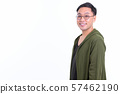 Profile view of happy Japanese man with eyeglasses looking at camera 57462190