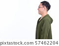 Profile view of happy Japanese man with eyeglasses smiling 57462204