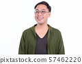 Face of happy Japanese man with eyeglasses thinking and looking away 57462220