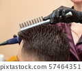 Comb out process, photographed in hairdressing 57464351
