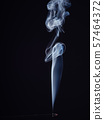 Abstract swirl of white smoke from burning incense 57464372