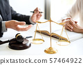business people and lawyers discussing contract 57464922
