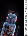 Vintage robot tin toy on yello background 57465883