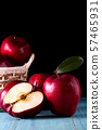 Red apples with leaves on the table 57465931