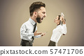 Angry business man screaming at employee in the office 57471706