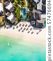 Aerial view of amazing tropical white sandy beach with palm leaves umbrellas and turquoise sea 57476694