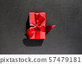 Red Gift box  with red ribbon on black background 57479181