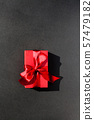 Red Gift box  with red ribbon on black background 57479182