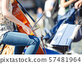Cello player in the street among the people 57481964