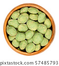 Wasabi peanuts in wooden bowl 57485793