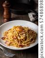 carbonara spaghetti with raw egg yolk on top 57486898