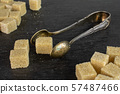 Brown sugar cube on grey stone 57487466