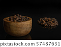 Dry brown clove isolated on black glass 57487631