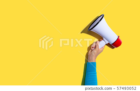 Person holding a megaphone 57493052