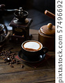Cup of coffee latte and coffee beans with coffee dripper set on wood table. 57496692