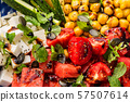 Chickpea watermelon salad with feta and tomatoes 57507614
