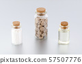 natural medicine bottles with herbal pills, globules and oil on gray background 57507776