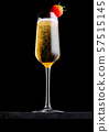 Elegant glass of yellow champagne with strawberry 57515145