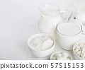 Fresh dairy products on white table background. 57515153
