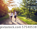 Young couple stretching legs on a road at the park 57540538