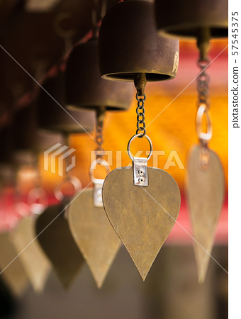 Ancient wind bell made by bronze hanging in temple 57545375
