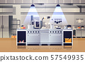 modern interior of professional cafe or restaurant kitchen with kitchenware and equipment cooking 57549935