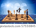 Businessman in large chess board in strategy concept 57550845