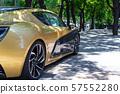Unrecognizable sports car. A sidewalk in a trendy 57552280