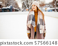 Cute and beautiful girl in a winter city 57566148