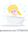 Baby taking a bath playing with foam bubbles and yellow rubber duck. 57568356
