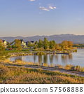 Trail and homes in Oquirrh Lake against mountain 57568888