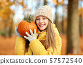 happy girl with pumpkin at autumn park 57572540