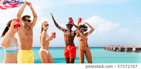 friends at american independence day beach party 57572707