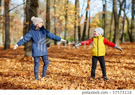 happy children having fun at autumn park 57573118
