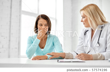 doctor and sad woman patient at hospital 57574196