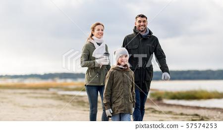 happy family walking along autumn beach 57574253
