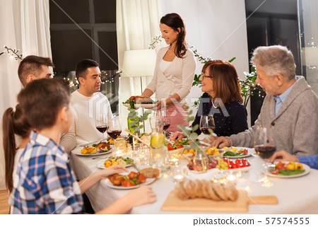 happy family having dinner party at home 57574555