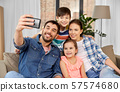 happy family taking selfie at home 57574680