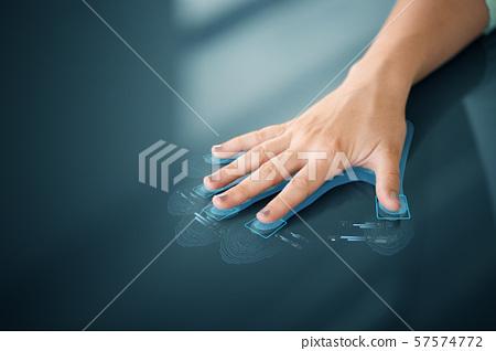 hand on touch screen scanning fingerprints 57574772
