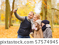happy family with camera in autumn park 57574945