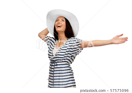 young woman in striped tunic and sun hat 57575096
