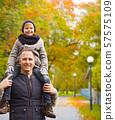 happy family having fun in autumn park 57575109